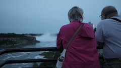 Old couple look out over the falls Stock Footage