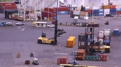 Stock Video Footage of HONOLULU, HAWAII - JULY 2015: Fork Lift moving Shipping Containers around dock