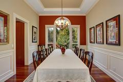 Dinning room with large table and lots of chairs. Stock Photos