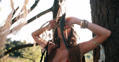 Beauty portrait of a boho girl in afternoon sunlight Stock Footage
