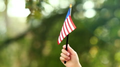Close up of little boy waving american flag - stock footage