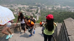 Tourists visiting the Great Wall of China on the outskirts of Beijing Stock Footage