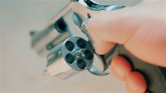 Footage of a Revolver being loaded with bullets - stock footage