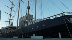 Tall ship sits in city of Toronto harbor Stock Footage