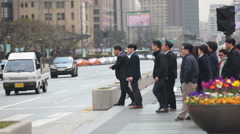 Crowd of businessmen in a hurry crossing a busy intersection. - stock footage