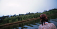 Ethereal hippie girl gazing at you in calm water - stock footage