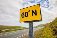 The 60th northern degree of latitude intersects the road A 970 on Mainland Stock Photos