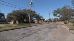 A New Orleans neighborhood street - still in disrepair after Hurricane Katrina Stock Footage