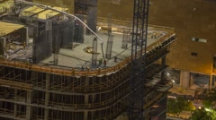 Construction crew pouring concrete in the new skyrise Stock Footage