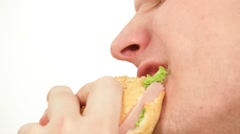 Man eating a big hamburger - fast food Stock Footage