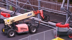 HONOLULU, HAWAII - JULY 2015: Forklift lifts metal beam up to workers Stock Footage