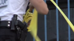 Rolling up Crime Scene Tape - Police Stock Footage