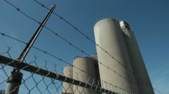 Power Plant Beyond Chainlink Fence And Barbed Wire 2 Stock Footage