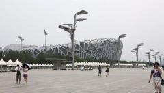 Tourists walk on the Pedestrian walkway in the Olympic Park in Beijing Stock Footage