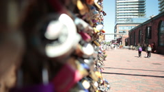 Rack Focus to Love Padlocks from people passing in the background Stock Footage