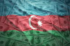 Colorful waving azerbaijani flag on a american dollar money background Stock Photos