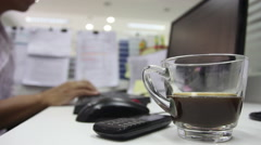Man is working computer and drink Coffee. - stock footage