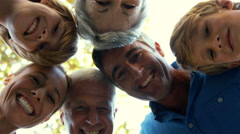 Happy family looking down the camera - stock footage