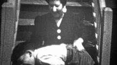 1943: Boy spanked and then sister saves him and ridicules mom. Stock Footage