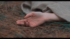 Womans hand showing out of potato sack Stock Footage