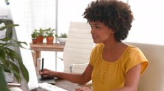 Happy casual businesswoman using computer Stock Footage