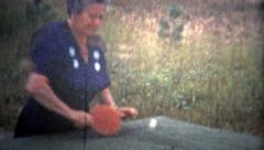 1953: Old woman practicing table tennis is steadily improving. Stock Footage