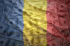 colorful waving romanian flag on a american dollar money background - stock photo