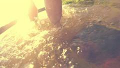Woman walking in shallow water and comes to the sandy river bank. Slow motion - stock footage