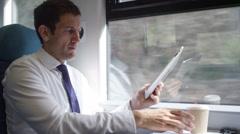 4k Businessman working on digital tablet on train journey Stock Footage