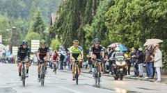 Four Cyclists Riding in the Rain - Tour de France 2014 - stock photo