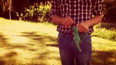 Man putting gardening glove in the park Stock Footage