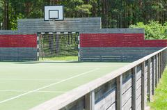 Soccer goal and basketball hoop on universal outdoor playground with syntheti - stock photo