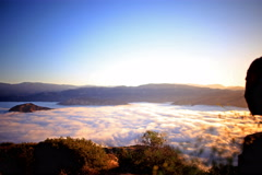 5K 3 Axis Motion Control Time Lapse of Sunrise over Golden Sea of Clouds Stock Footage