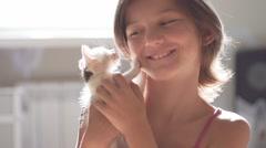 Girl caressing Kitten Slow Motion Stock Footage