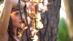 Beauty shot of wild looking girl in Native American style Stock Footage