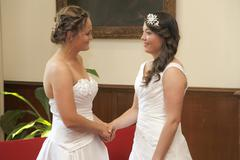 two brides on the verge of getting married - stock photo
