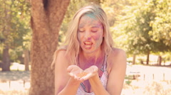 Young woman having fun with powder paint Stock Footage