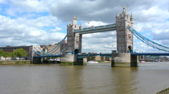 Tower Bridge spanning over River Thames London UK Stock Footage