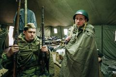 Unidentified re-enactors dressed as Soviet soldiers during event - stock photo