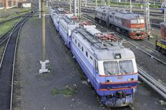 Electric CHS2K-741 is on the tracks at a railway station - stock photo