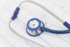 Stethoscope with ekg cardiogram chart - close up studio shot - stock photo