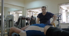 Man making great efforts to do exercise with weight plate Stock Footage