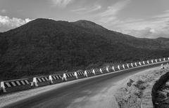 Curving mountain road. B&W - stock photo