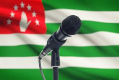 Microphone with national flag on background series - Abkhazia - stock photo