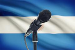 Microphone with national flag on background series - Argentina - stock photo