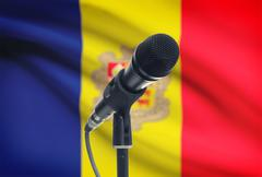 Microphone with national flag on background series - Andorra - stock photo