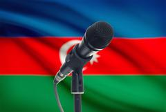 Stock Photo of Microphone with national flag on background series - Azerbaijan