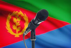 Microphone with national flag on background series - Eritrea Stock Photos