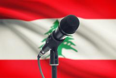 Microphone with national flag on background series - Lebanon Stock Photos
