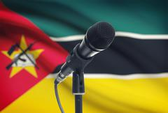 Microphone with national flag on background series - Mozambique - stock photo